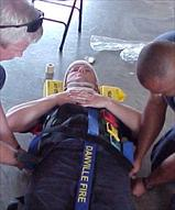 Immobilization Straps Being Placed on Person on Stretcher