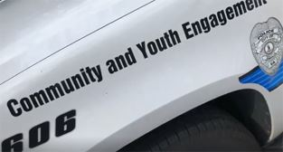 Police car with Community and Youth Engagement logo