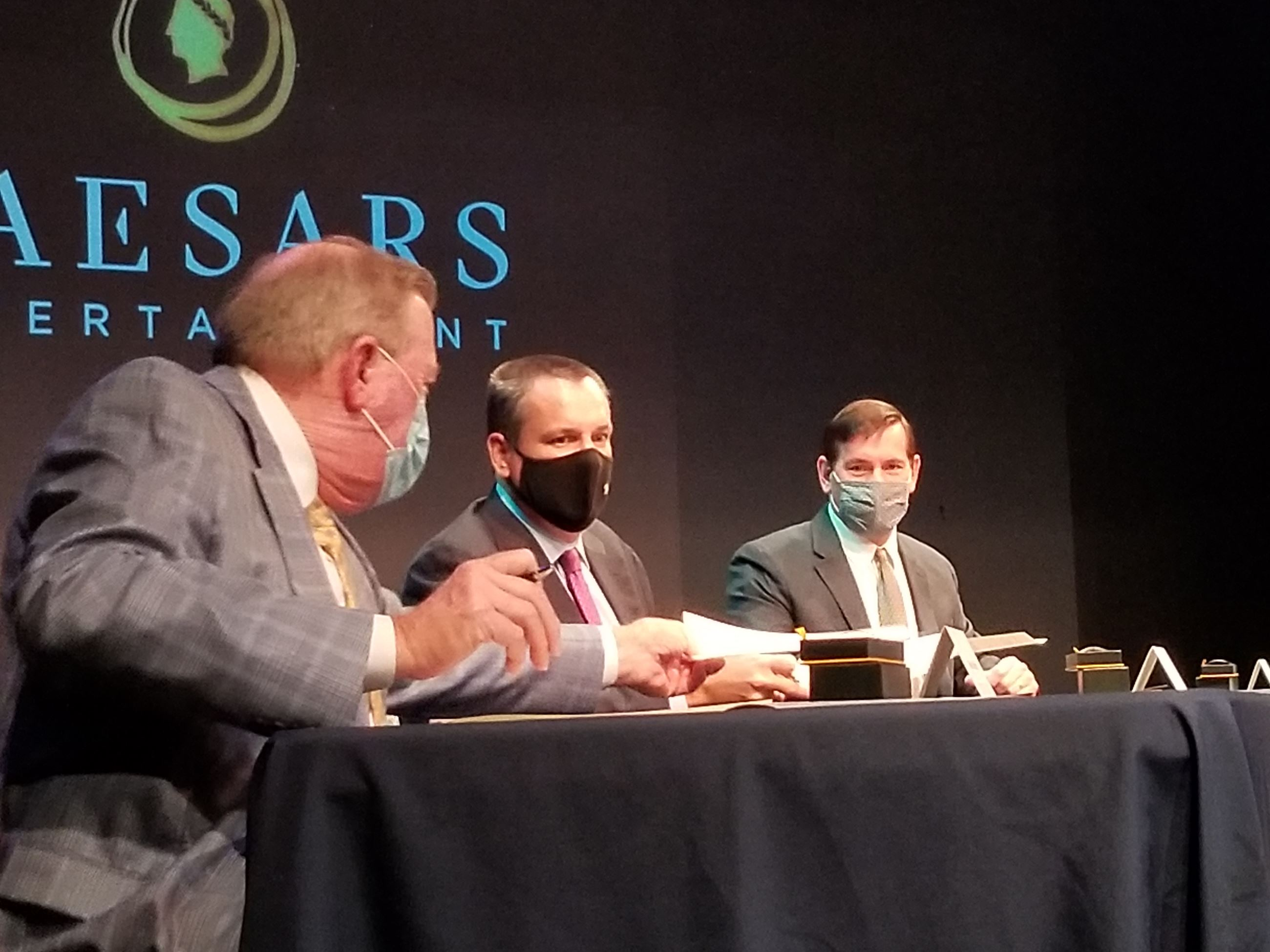 (Left to right) Neal Morris, Tom Reeg and Ken Larking sign resort casino agreement on Thursday.